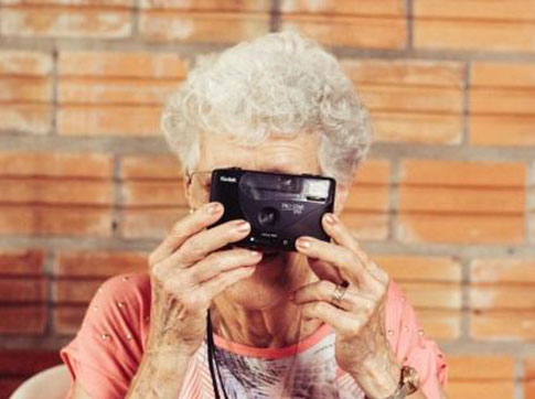 Lady Looking Through Camera Lens