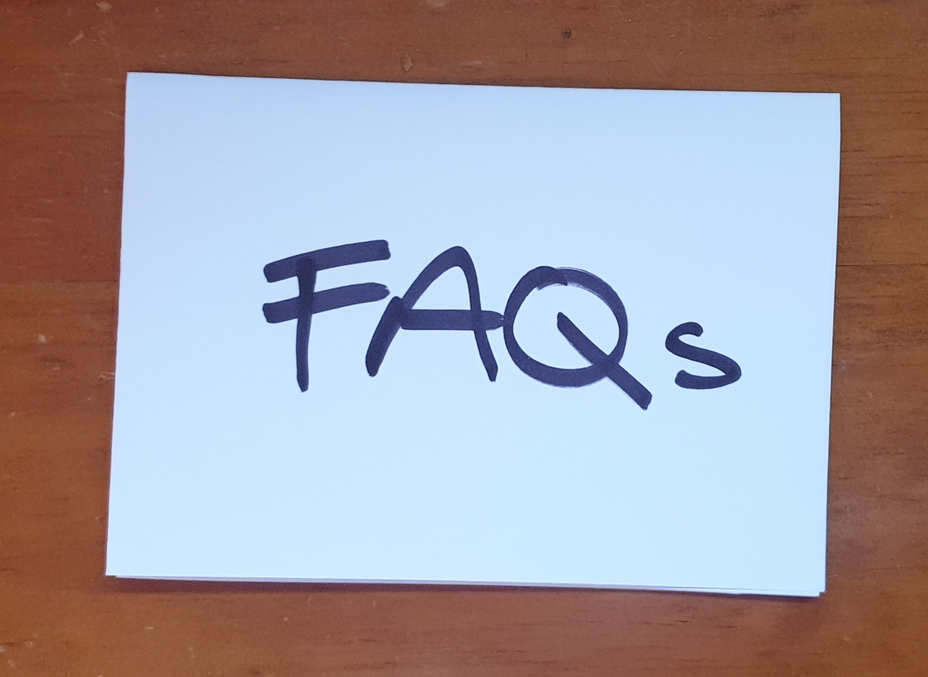 FAQs note on wooden desk